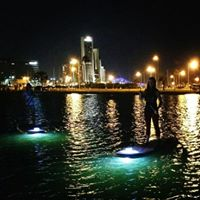 Paddleboard night tour with Water Dog Floating Yoga
